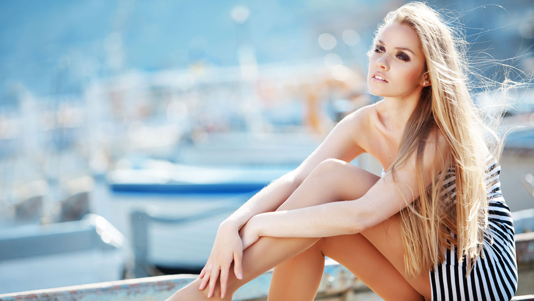 A beautiful girl is sitting on a boat